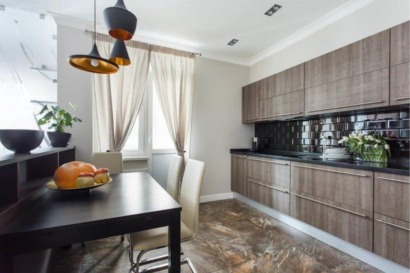 Пол из камня коричневого цвета в интерьере кухни