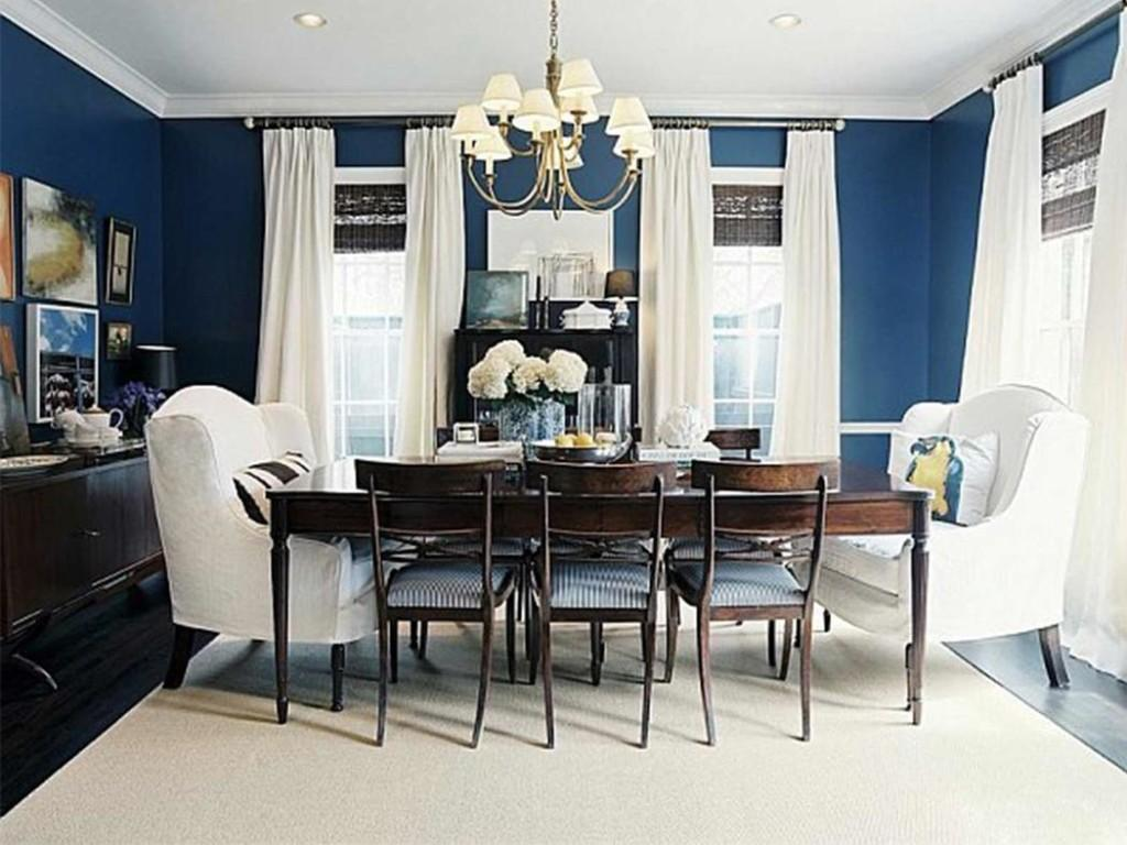 Белая мебель и шторы в гостиной столовой