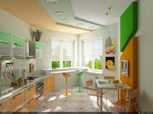 Достоинства эркера в кухне можно подчеркнуть освещением и контрастными цветами