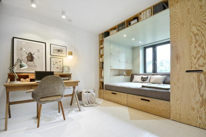 шкаф со кроватью вокруг окна в интерьере